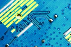 Electronic PCB Printed Circuit Board. In macro close-up with transistors circuitry and electric hardware elements including computer chip with copy space for Royalty Free Stock Images