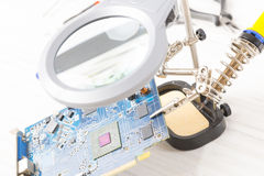 Electronic PCB on third hand tool Stock Image