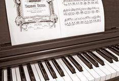 Electronic piano. Close up with notes Royalty Free Stock Image