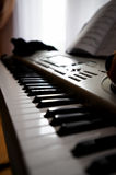 Electronic piano and book for notes Royalty Free Stock Images