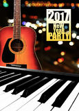 Electronic Piano Keyboard and Guitar on bokeh background. Stock Image