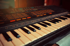 Electronic piano keyboard. Old model Electronic piano keyboard stock photo