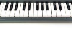 Electronic Piano keyboard on white background Royalty Free Stock Photos