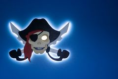 Electronic piracy. The theft of intellectual property. Jolly Roger in a modern style. Place for your text. Royalty Free Stock Image
