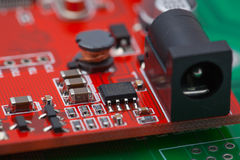 Electronic power module on red pcb Royalty Free Stock Photo