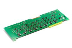 Electronic printed circuit board with chips and other components, green color, back side, angled view, isolated on white. Background stock photo