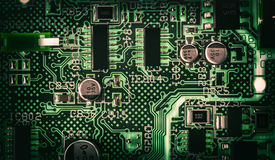 Electronic printed circuit board. Detail of an electronic printed circuit board with many electrical components Stock Photography