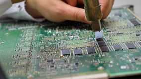 Electronic printed circuit board with many electrical components. Detail of an electronic printed circuit board with many electrical components Royalty Free Stock Photos