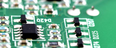Electronic printed circuit board with many electrical components Stock Images