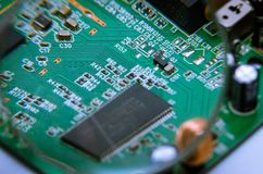 Electronic printed circuit board with soldered cable. View through a magnifying glass. stock photography