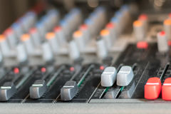 Electronic professional sound mixer control panel in music studi Stock Images