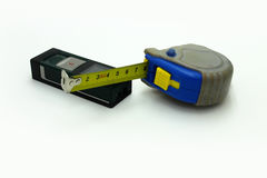 Electronic rangefinder and manual measuring tape Stock Photo