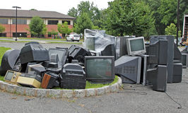 Electronic Recycling Day. A pile of old TV sets, computers, monitors and other PC parts, collected for recycling stock photo