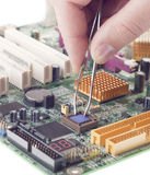Electronic repairs. Repair of the damaged electronic equipment on board pcb stock image