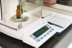 Electronic scales in chemical laboratory Stock Image