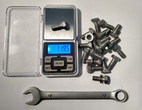 Electronic scales measure the weight of the bolt royalty free stock photo