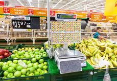 Electronic scales in produce department of the Auchan store Royalty Free Stock Photography