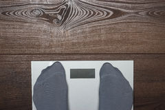 Electronic scales on the wooden floor Stock Photography