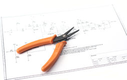 Electronic schematic with tools. Electrical drawing with tools as in a repair guide, selective focus Royalty Free Stock Photography