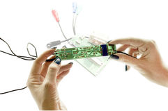 Electronic schemes in hands Stock Photography