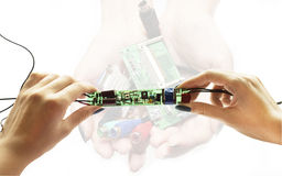 Electronic schemes in hands Royalty Free Stock Image