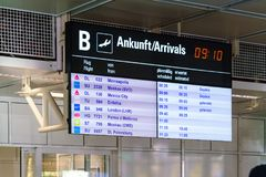 Electronic scoreboard with the schedule of arrival. Munich, Germany - October 14, 2017: Electronic scoreboard with the schedule of arrival of planes at the Royalty Free Stock Photos