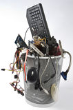 Electronic scrap in trash can Stock Photography