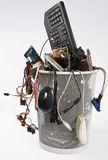 Electronic scrap in trash can Stock Image