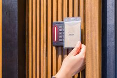 Electronic security key lock on wooden door Stock Image
