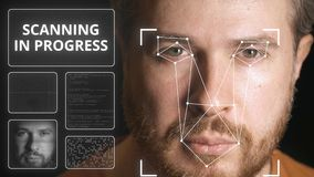 Electronic security system scanning man`s face. Computer security system scanning man`s face stock footage