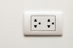 Electronic socket on white wall Stock Photography