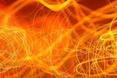 Electronic Spaghetti. A handheld long time exposure of neon signs in a bar creates electronic spaghetti, weird, bizarre, abstract, impressionistic red, orange Stock Photo