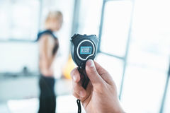 Electronic sport timer in hand stock photography