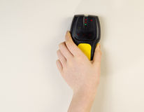 Electronic Stud Finder against interior wall of home Stock Images