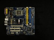 Electronic system of a computer motherboard, digital chip with a transistor, a microcircuit on a black background royalty free stock photo