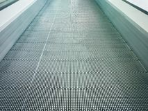 Electronic system moving or Modern escalator in shopping mall. stock images