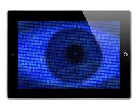 Electronic tablet binary background. An iPad or mobile electronic tablet display with a blue binary code background on an eye royalty free stock images