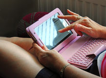 Electronic tablet device user Stock Images