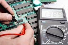 Electronic technician. Man repairing electronics stock images