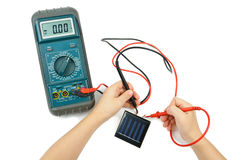 Electronic tester and solar battery Stock Photos