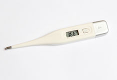 The electronic thermometer on a white background Stock Photos