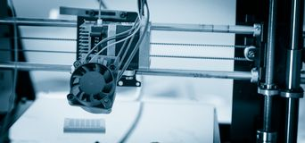 Electronic three dimensional plastic printer during work , 3D printer, 3D printing. stock photography