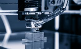 Electronic three dimensional plastic printer during work , 3D , printing. royalty free stock image