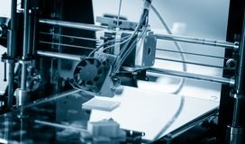 Electronic three dimensional plastic printer during work , 3D printing Stock Image