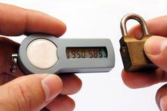 ELECTRONIC TOKEN. Handling a ELECTORNIC TOKEN to unlock the net-bank door Stock Images
