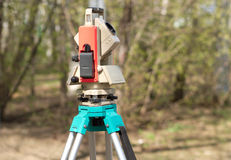 Electronic total station on tripod Stock Photography