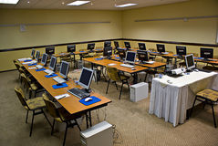 Electronic Training Conference. 21 seated electronic workstation positions. Ideal for Instructor lead electronic/computer aided training session. Alternate angle Royalty Free Stock Photos