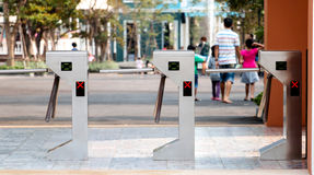 Electronic turnstiles in front of amusment park Royalty Free Stock Images