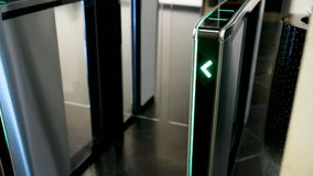 Electronic Turnstiles. Green LED light arrow pointing up and moving fast upwards.  stock footage