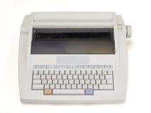 Electronic typewriter. White electronic typewriter on a white background royalty free stock photo